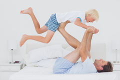 Father holding his son in the air Royalty Free Stock Images