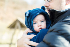 Father holding his son in his arms Stock Images