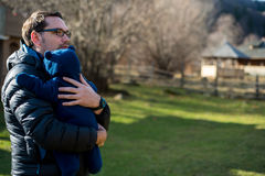 Father holding his son in his arms Stock Photography