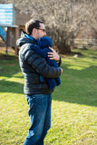 Father holding his son in his arms Royalty Free Stock Image