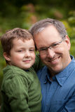 Father and son smiling Royalty Free Stock Image