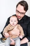 Father holding his son in his arms Royalty Free Stock Photos