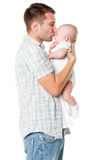 Father holding his son and kissing him. Isolated on white background Royalty Free Stock Photos