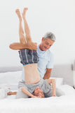 Father holding his son upside down Royalty Free Stock Photos