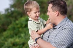Father holding his 2 year old son Royalty Free Stock Images