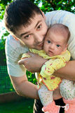 Father holding and kissing newborn royalty free stock images