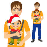 Father holding little boy with baby carrier Stock Photo