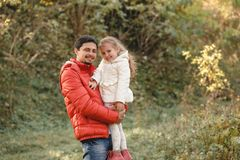 Father walks with little daughter girl and smiles happily royalty free stock photos