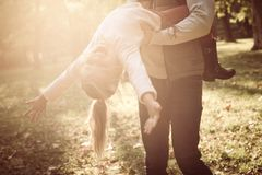 Single father in park with daughter. Father holding little girl and rotate in circle stock images