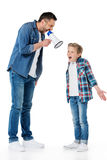 Father holding megaphone and screaming at little son standing Royalty Free Stock Photography