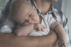 Father Holding Newborn Baby Son Stock Photos