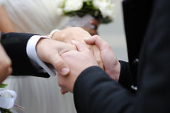 Father holding newlyleds hands Stock Image