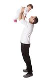 Father holding small baby aloft Stock Image