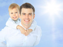 Father holding son on. His shoulders dorable arms baby beach beautiful blue boy caucasian child cloud cute dad daddy Stock Photography