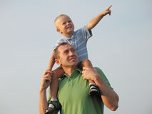 Father Holding son. On a Shoulder Stock Images