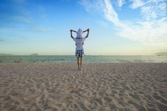 Father holding son on his shoulders at the beach. With blue sky Royalty Free Stock Images