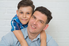 Father holding son on his shoulders, closeup portrait.  Royalty Free Stock Photo