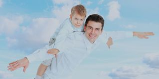 Father holding son on his shoulders. Father holding son on his shoulders royalty free stock photography