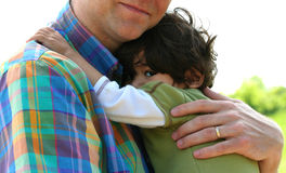Father holding son outdoors Stock Photography
