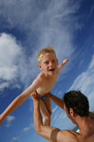 Father holding son overhead. Young dad holding his son above his head Stock Images