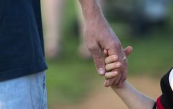 Father holding son's hand Royalty Free Stock Images