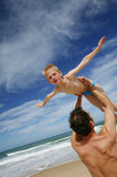 Father holding son by the shore Royalty Free Stock Image