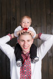 Father holding son on shoulders in studio. Background Royalty Free Stock Photography