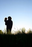Father Holding Son Silhouette Royalty Free Stock Photography