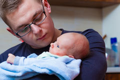 Father holding taking care of newborn baby Royalty Free Stock Images