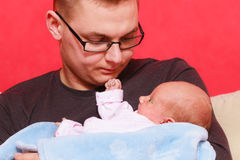 Father holding taking care of newborn baby Royalty Free Stock Image