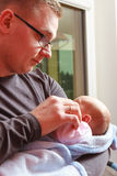 Father holding taking care of newborn baby Stock Photo
