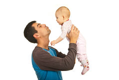 Father holding up his baby girl. Isolated on white background royalty free stock photography