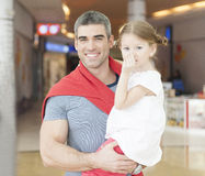 Father holding young daughter up at waist height Stock Photos