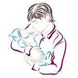 The father holds the baby in his arms and kisses his hand tender. Ly Royalty Free Stock Photo