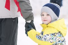 Father holds the boy`s hand in winter clothes, winter, family, hand in hand, lifestyle stock photos