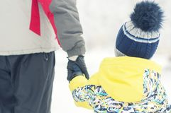 Father holds the boy`s hand in winter clothes, winter, family, hand in hand, lifestyle. Portrait Stock Image
