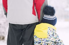 Father holds the boy`s hand in winter clothes, winter, family, hand in hand, lifestyle. Portrait Stock Photo