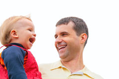 Father holds child on hands and laugh Stock Image