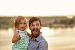 Father holds on hands daughter. royalty free stock images