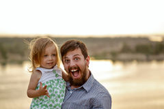 Father holds on hands daughter. royalty free stock photography