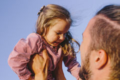 Father holds on hands him little daughte Stock Image
