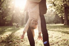 Single father with daughter in park. royalty free stock photos