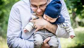 Father holds his son Stock Photos