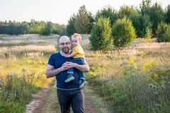 Father holds his toddler royalty free stock images