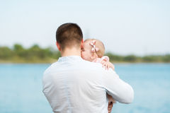 The father holds the little daughter on hands. Royalty Free Stock Photography