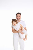 The father holds the little daughter in his arms Stock Photos