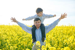 Father holds a small son on his shoulders Stock Photography