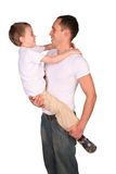 Father holds son face-to-face Royalty Free Stock Image