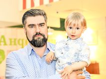 Father holds two-year-old son in his arms. Concept of fatherly love. royalty free stock photos