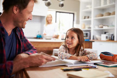 Father home schooling his young daughter Royalty Free Stock Photos